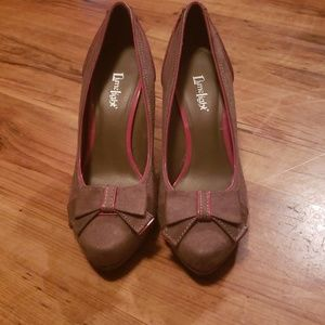 Adorable heels with bows. Never worn.
